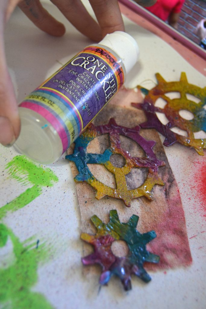 To add texture, I added a small amount of DecoArt's One Step Crackle and then hit it with my head gun. This caused it to bubble up and add texture and interest to my gears.